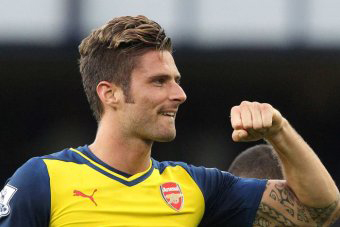 Oliver Giroud celebrates after 90th minute goal  to draw against Everton